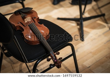 Violin on the Chair Intermission Rest Time 35mm Close Up Background Photo Stock photo ©