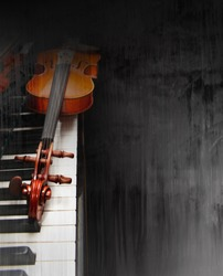 Violin on the piano on a grunge background