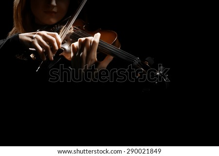 Violin player violinist hands. Musical instruments orchestra music playing violin closeup