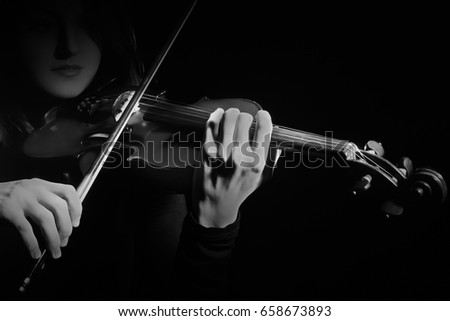 Violin player. Violinist playing violin bow in hands.