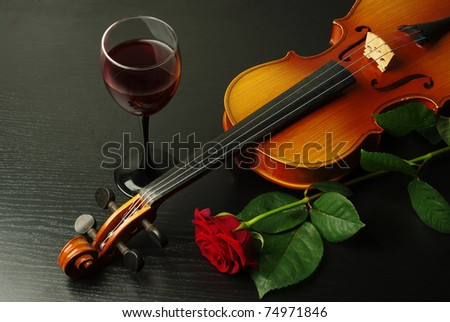 Violin, red rose and glass of wine