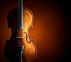 Violin resting against a blank grunge background with copy space