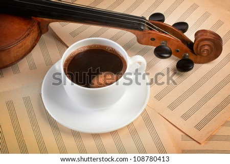 violin with hot coffee cup