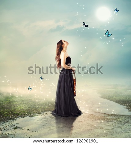 Stock Photo Violinist at a brook under the moon light (with butterflies)