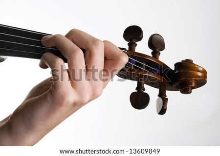 Violinist playing the violin close of the hand and fingers - stock photo