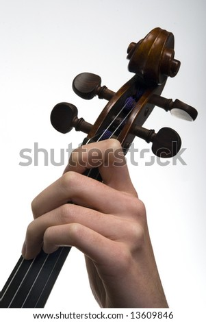 Violinist playing the violin, close-up of the hand and fingers