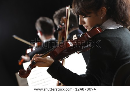 Violinist woman playing a concert of classical music - stock photo
