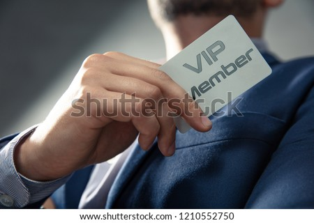 VIP member card holded by an elegant man in suit. Stock photo ©