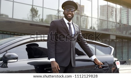 Vip passenger taxi driver politely opening car door for his client, best service #1112129828