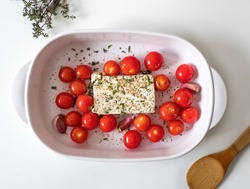 Viral Feta bake pasta recipe with tomatoes, garlic and herbs in a casserole dish