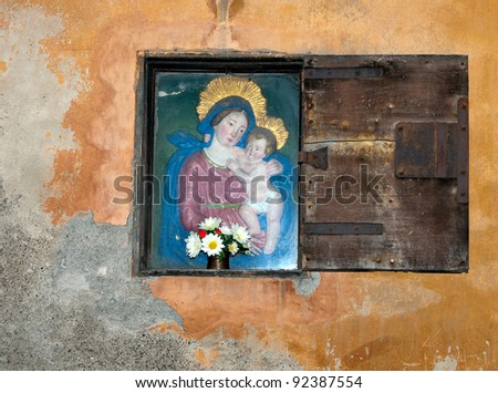 Virgin Mary and Baby Jesus - with flowers, Volterra, Italy