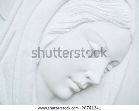 virgin mary on white marble tombstone