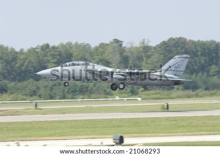 Virginia Beach, VA - Sept 17: A US Navy F-14 on take off during the second to last performance prior to retirementat the NAS Oceana airshow on September 17, 2005 in Virginia Beach, VA.