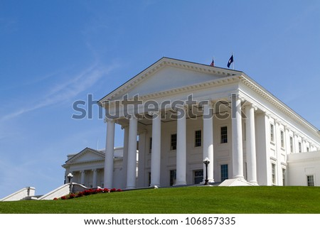 Virginia Statehouse building in Richmond, Virginia, USA against a blue sky background.