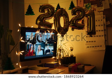 Virtual Christmas New Year's meeting team teleworking. Family video call remote conference. Laptop screen view. 2021 meet working from their home offices. Happy hour party online woman team diversity