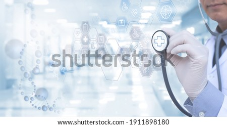 Virtual hospital, telemedicine, medical online, telehealth, healthcare and modern technology concept. Doctor working on digital tablet with medical icons on virtual screen, blurred hospital background