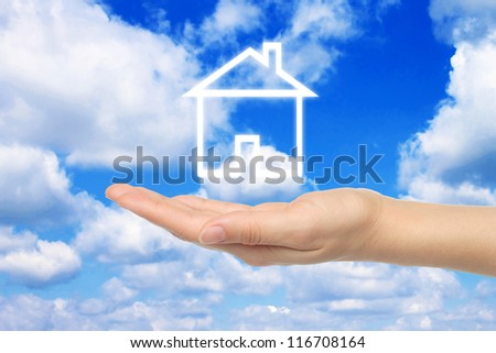 Virtual house with woman hand on sky background