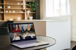 Virtual meeting team teleworking. Family video call remote conference. Laptop webcam screen view. Diverse portrait headshots meet working from their home offices. Happy hour party online