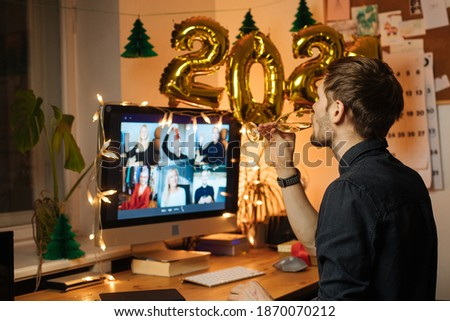 Virtual New Year 2021 meeting team teleworking. Family video call remote conference. Laptop webcam screen view. Team meet working from their home offices. Happy hour party online woman team diversity