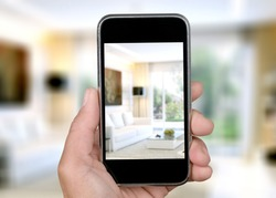 Virtual Open House Showing Or Online Tour with a smartphone in hand