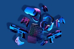 Virtual reality gogles, gamepads and blaster game controllers, games keyboard, mouse and headset. Concept of virtual reality, games, entertainment and communication.