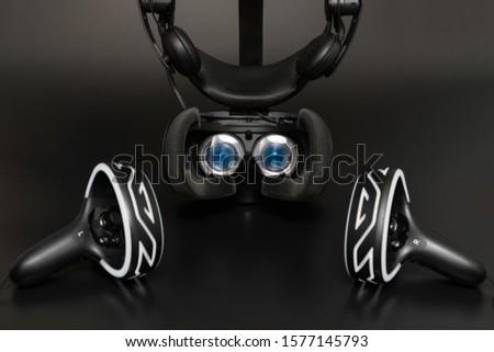 Virtual reality headset blue lenses, black background #1577145793