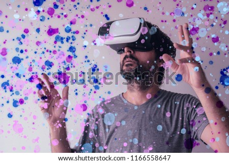 Virtual reality immersion, man wearing VR headset #1166558647