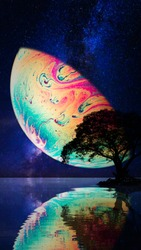 Virtual reality space with abstract multicolor psychedelic planet at night starry sky over water. Closeup of soap bubble like an alien planet in cosmos