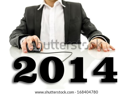 Virtual 2014 sign attached to computer mouse cable used by businessman. - stock photo