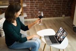 Virtual Wine Tasting Dinner Event Online Using Laptop