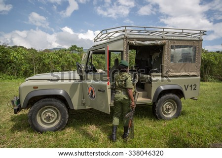 Virunga National Park, DR.Congo - October 7th 2015 - A army soldier in a safari car inside the Virunga National Park in Africa, DRC, Central Africa.