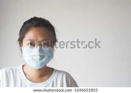 Virus mask Asian woman wearing face protection in prevention for coronavirus on white background with copy space.