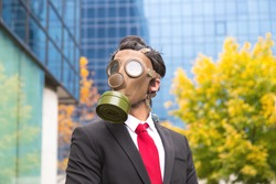 Virus pancemic. Man dressed with a suit with a mask gas