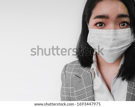 Virus scare Asian woman shocked wearing coronavirus mask protection looking scared on white background
