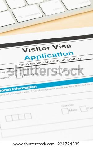 Visa application form with keyboard; form is mock-up