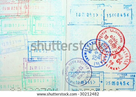 Visa entry and exit stamps in a passport
