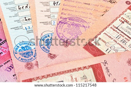 Visa entry and exit stamps in passport