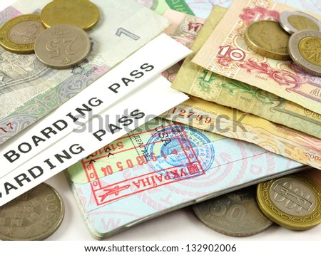 Visa stamp, boarding passes, foreign currency and coins
