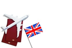 Visa to Britain concept. Text visa near passport cover and british flag on white background top view
