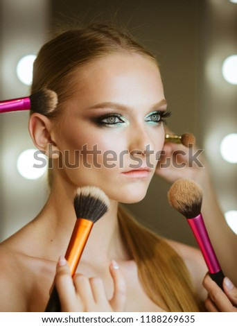 Visage course, professional make up. Woman getting powder on skin with brushes, makeup. Hands apply makeup on model face. Woman with young face in beauty salon. Girl with healthy skin, skincare.