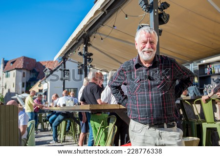 VISBY, SWEDEN -JUNE 10: Bjorn Hellberg poses after recording a TV show on June 10, 2014 in medieval Visby. Bjorn Hellberg is a popular TV personality and a successful author of criminal novels.