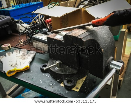 Vise desk technician. Carpentry Tools and Vise on Wooden Table art #533115175