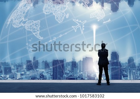 Vision concept. Successful businessman standing with hands crossed on chest, On top of building and looking through Cityscape Skyline Night Light. #1017583102