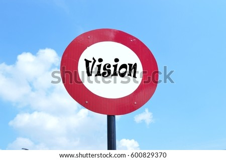 Vision is written on a round signboard with red outline and cloudy blue sky background  - Shutterstock ID 600829370