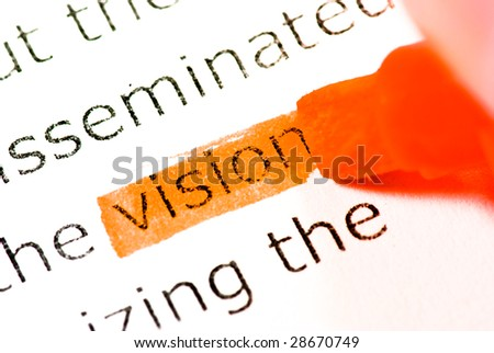 vision word and orange marker closeup