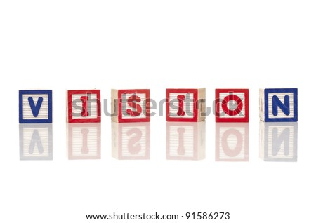 vision word at wood blocks isolated on white background