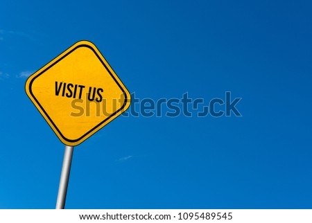 visit us - yellow sign with blue sky #1095489545