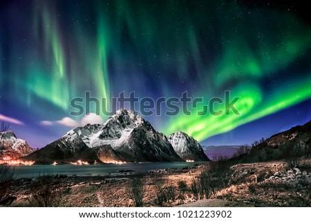Stock Photo Visiting the Lofoten Islands during winter time is a dream for all landscape photographers. At this time of the year, the colourful and enchanting Aurora Borealis light up the clear night skies above