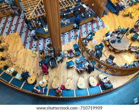 Visitors at the coffee shop in the shopping center in Stockholm, Sweden. Top view, from above