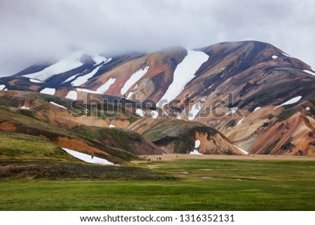 Visitors at the Landmannalaugar, a natural park in the Fjallabak Nature Reserve, famous for colourful mountains and natural geothermal hot springs, Southern Iceland, Scandinavia